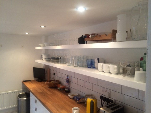 Long White floating kitchen shelves