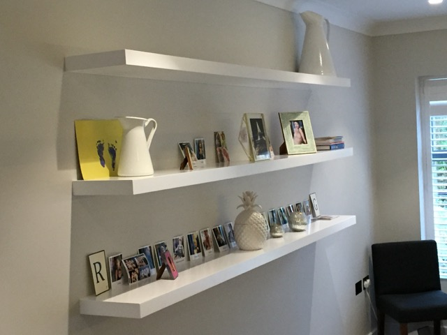 White floating display shelves