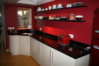 long kitchen black floating shelves