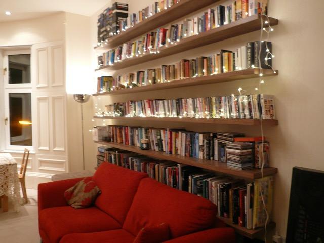 walnut floating shelves with books