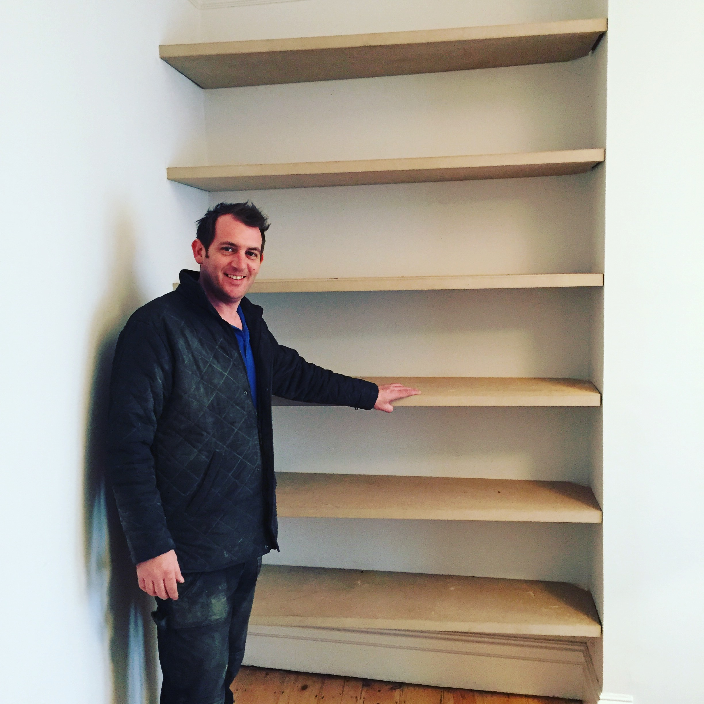 Made to measure mdf alcove shelves.