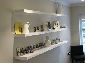 White floating display shelves