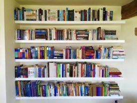 Floating white book shelves